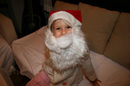 A small, smiling Santa